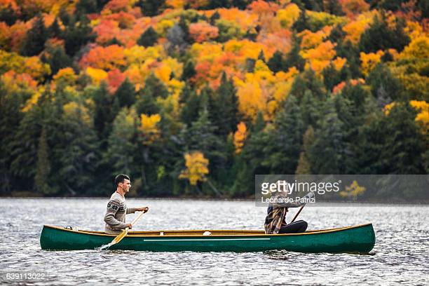 Couple enjoying a ride on a typical canoe in Canada