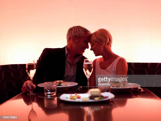 Couple enjoying a romantic meal.
