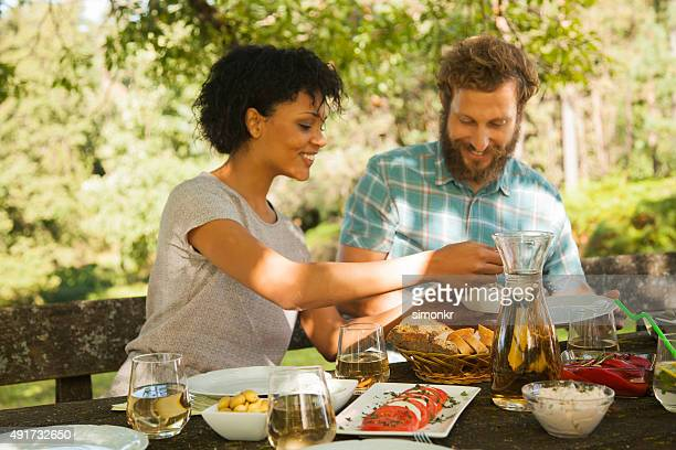 Couple enjoying barbecue at outdoors