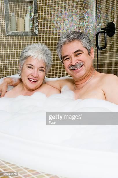 Couple enjoying bubble bath