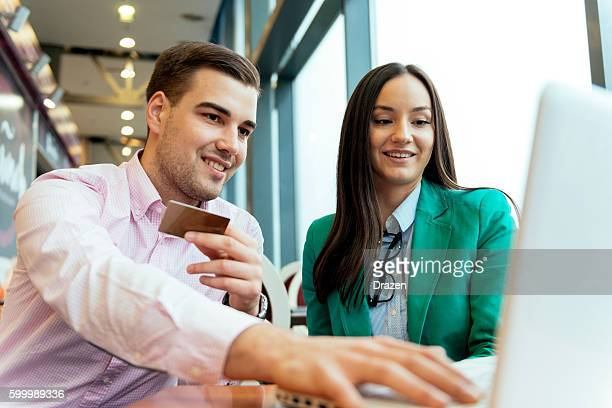 Couple enjoying buying items online