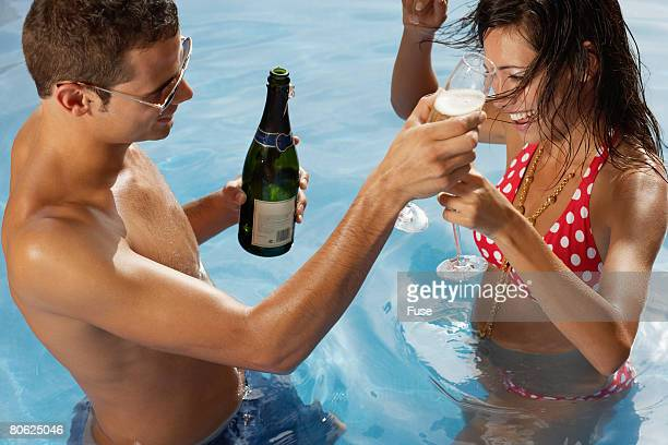 Couple Enjoying Champagne in the Pool
