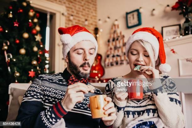 Couple enjoying Christmas cookies