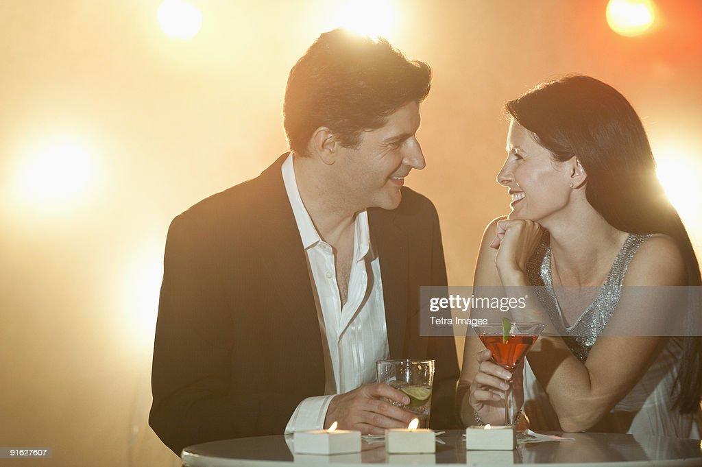 A couple enjoying cocktails