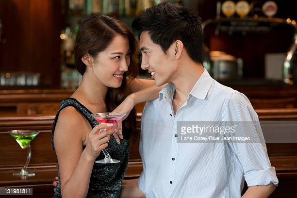 Couple Enjoying Cocktails Together