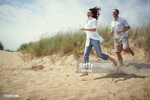 Couple enjoying day out at the beach : Stock Photo