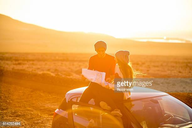 Couple enjoying desert roadtrip on the sunrise