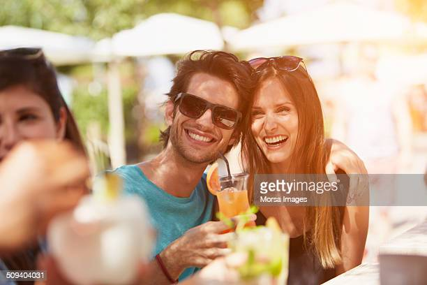 Couple enjoying drink at outdoor restaurant