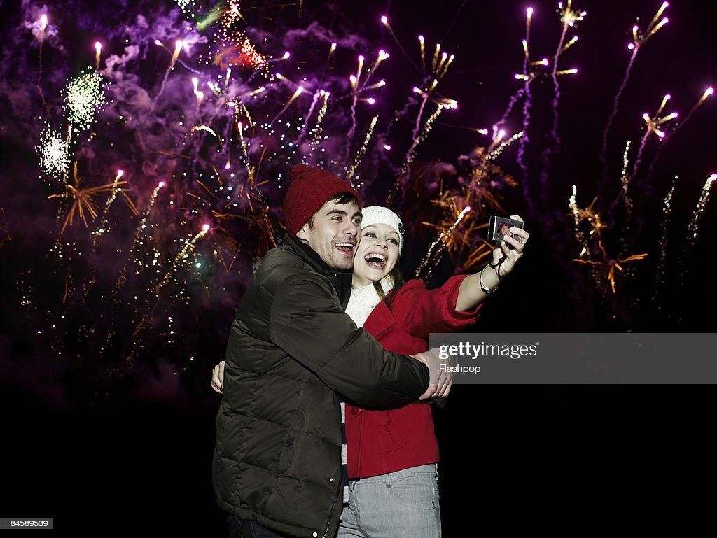 Couple enjoying firework display : Stock Photo