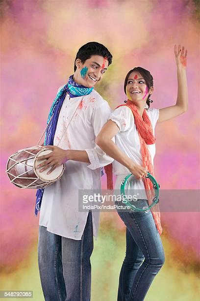 Couple enjoying Holi