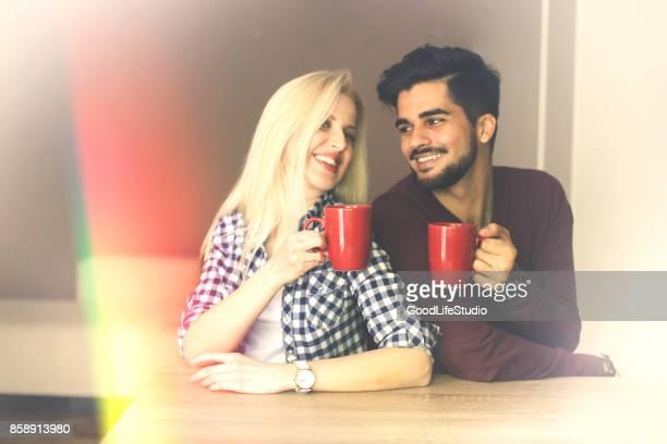 Couple enjoying hot drink