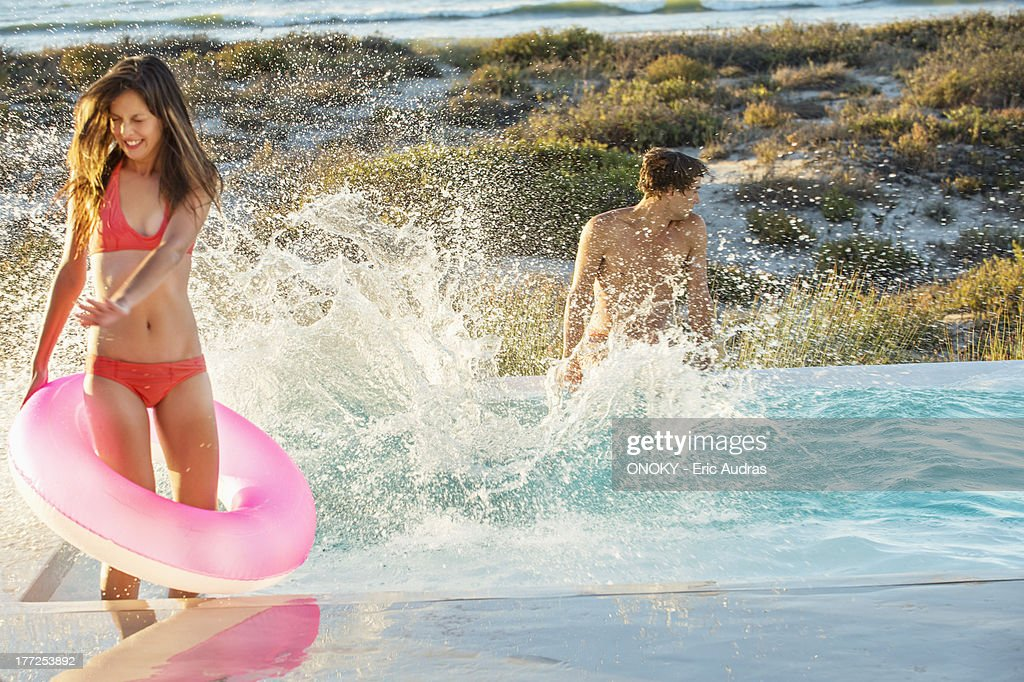 Couple enjoying in a swimming pool on the beach : Stock Photo
