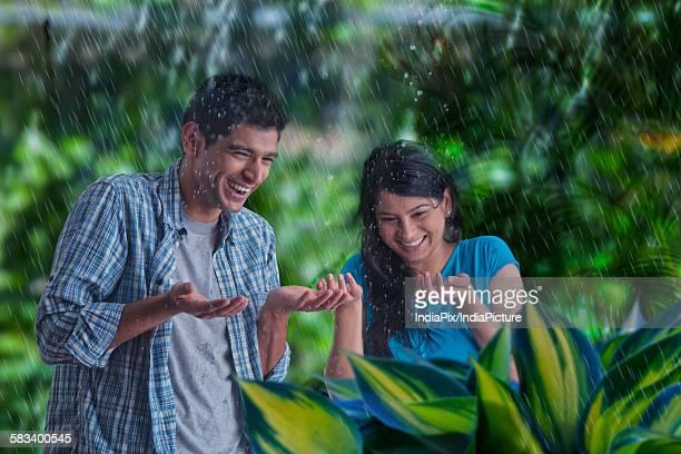 Couple enjoying in the rain