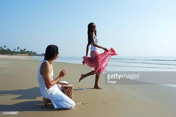 A couple enjoying music on a beach