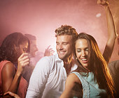 Couple enjoying on dance floor
