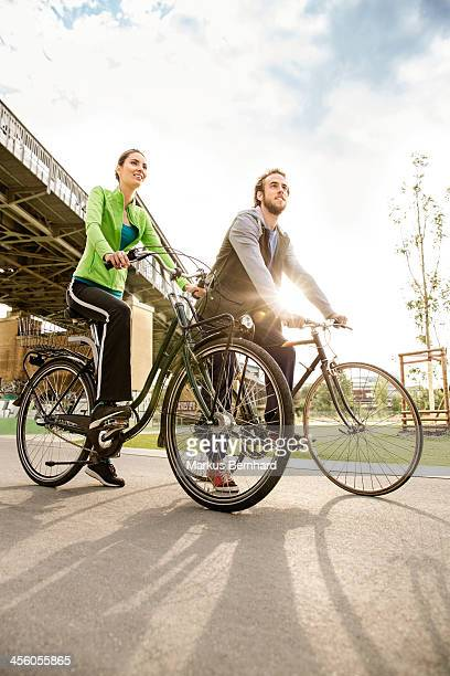 Couple enjoying ride with their bicycles.