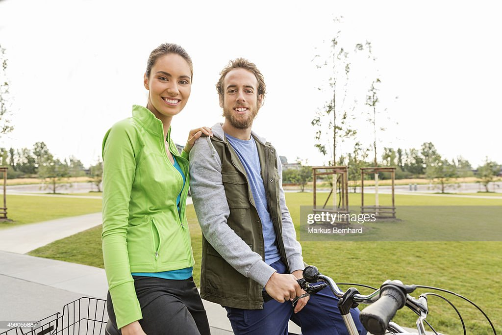 Couple enjoying ride with their bicycles : Stock Photo