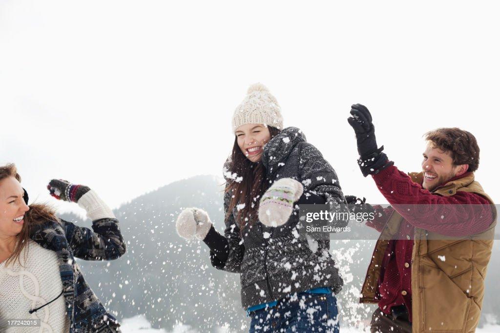Couple enjoying snowball fight : Stock Photo