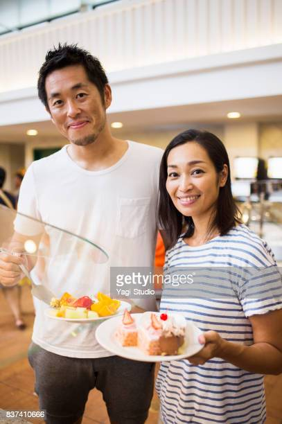 Couple enjoying take a buffet style meal at Resort Hotel in guam