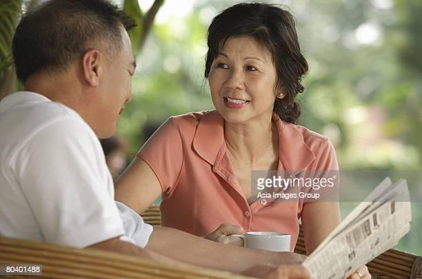 Couple enjoying tea at a cafe