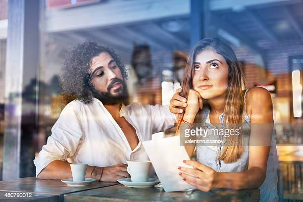 Couple enjoying tea in a restaurant