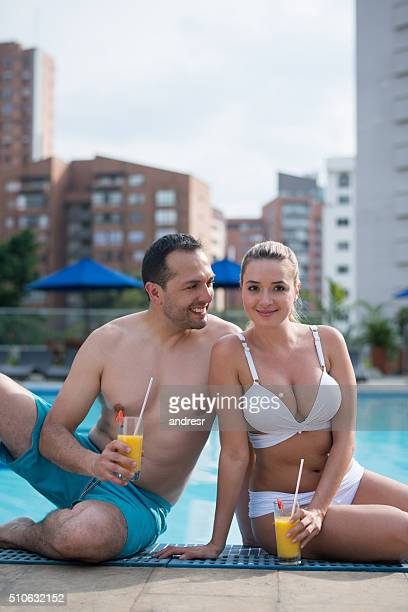 Couple enjoying the summer by the pool