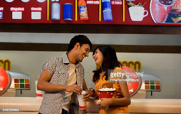 Couple enjoying themselves at a counter