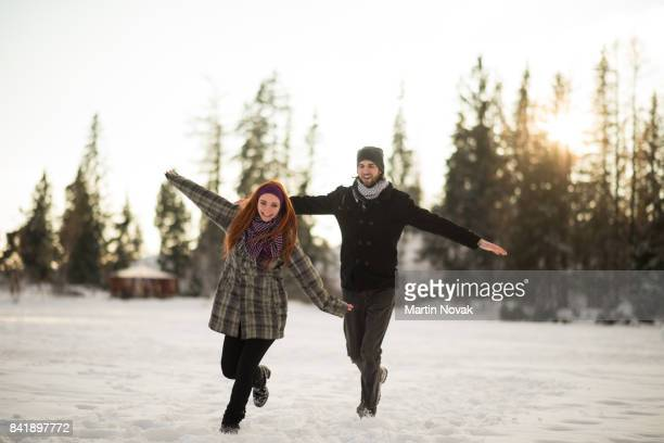 Couple enjoying together in snowy mountains