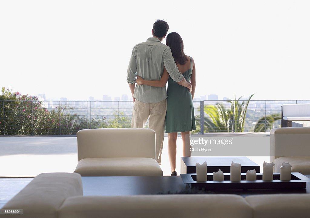 Couple enjoying view from balcony : Stock Photo