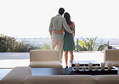 Couple enjoying view from balcony