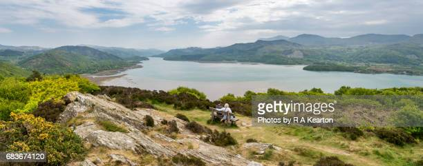 Couple enjoying view of the Mawddach estuary, Barmouth, Wales, UK
