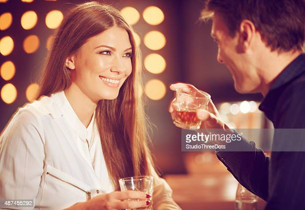 couple enjoying whisky