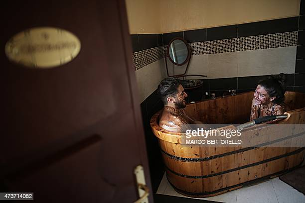 A couple enjoys a chocolate bath at the hotel and restaurant the 'CioccoLocanda' of Italian chocolate master Silvio Bessone on May 14 2015 in...