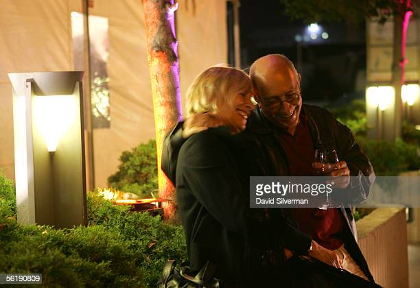 A couple enjoys a glass of Beaujolais Nouveau 2005 during a celebration for the young wine after midnight November 17 2005 in Herzliya central Israel...