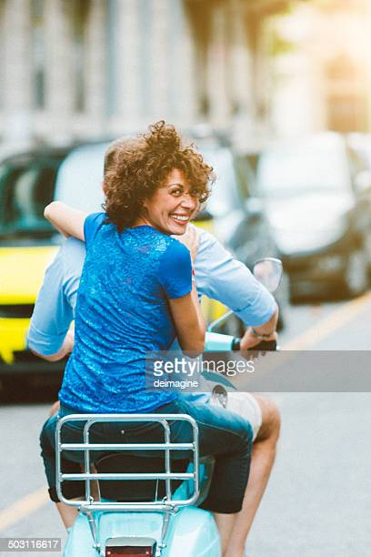 Couple enjoys on a scooter
