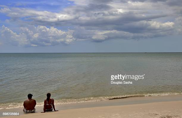 Couple enjoys the beach, Bowmans Beach, Sanibel, Florida, USA