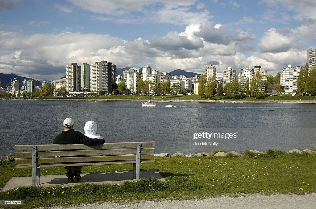 A couple enjoys the skyline view from across False Creek April 18 2004 in Vancouver Canada Though Canada's third largest city overall and British...