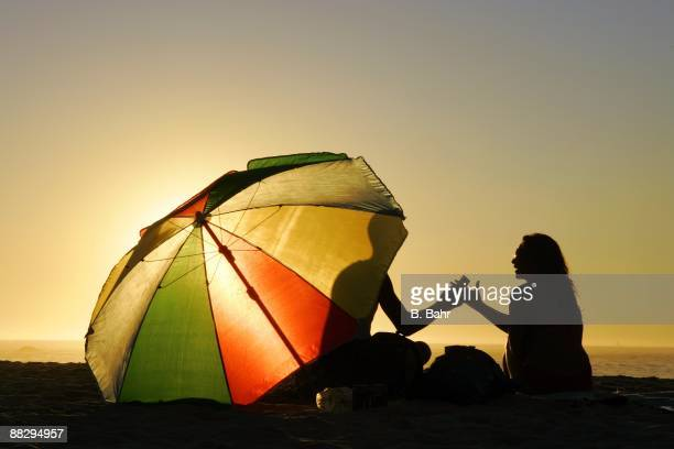 A couple enjoys the sunset at Camps Bay Beach on March 14 2009 in Cape Town South Africa South Africa will host the 2010 FIFA World Cup