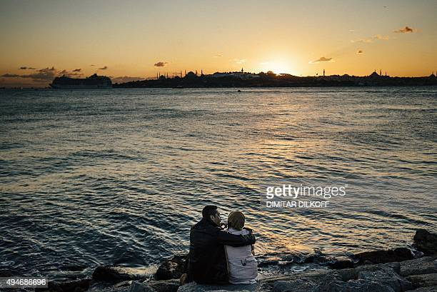 A couple enjoys watching the sunset over the Bosphorus in Istanbul on October 28 a week ahead of the country's general elections on November 1 The...