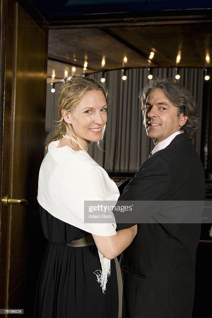 A couple entering a theater
