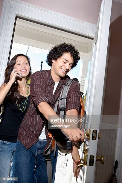 Couple entering home