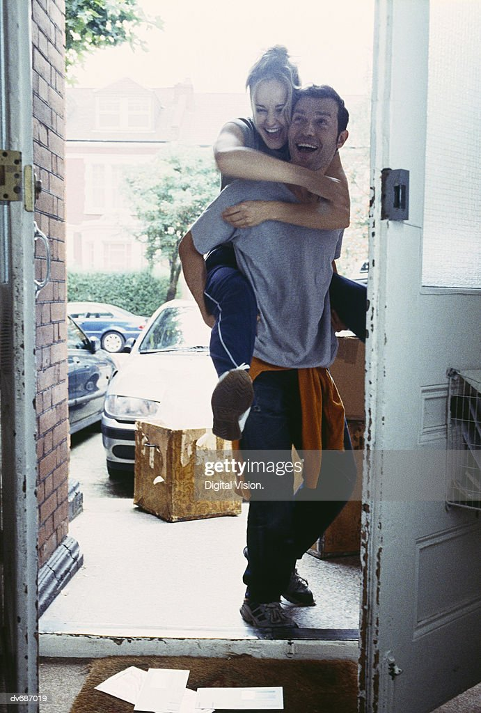 Couple Entering New Home