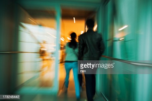 Couple Entering Store, Blurred Motion
