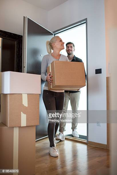 Couple entering the new flat