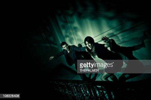 couple escaping from evil