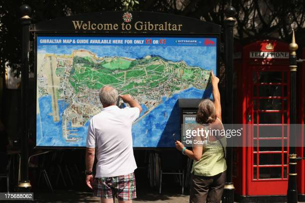 A couple examine a city map on Gibraltar's Main Street on August 6 2013 in Gibraltar Tensions between the British and Spanish governments have been...