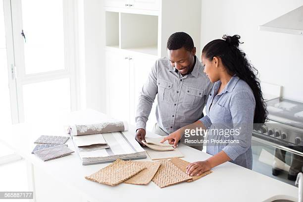 Couple examining fabric swatches in new home