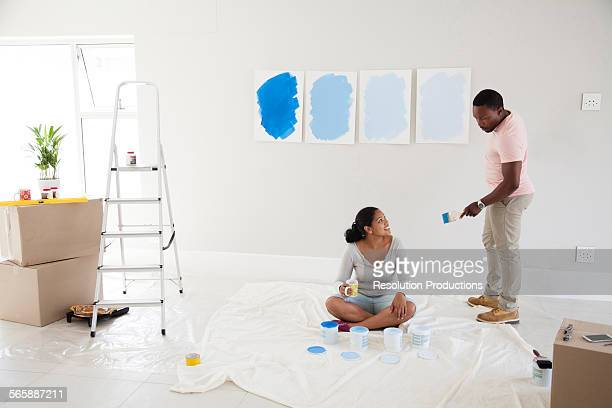 Couple examining paint samples in new home