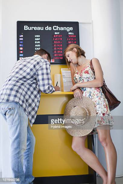 Couple exchanging currency