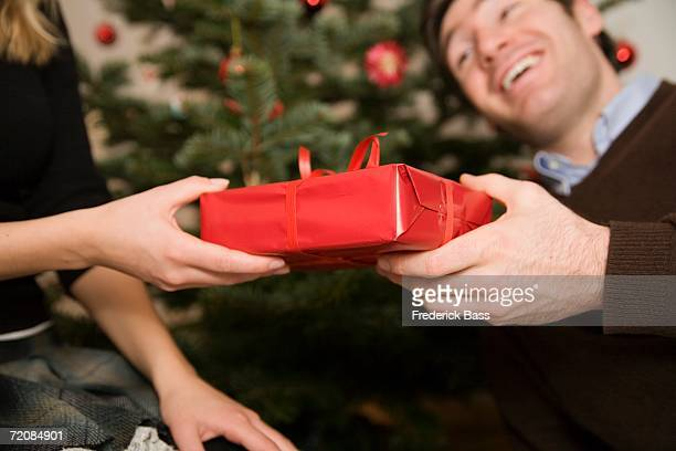 Couple exchanging gift at Christmas